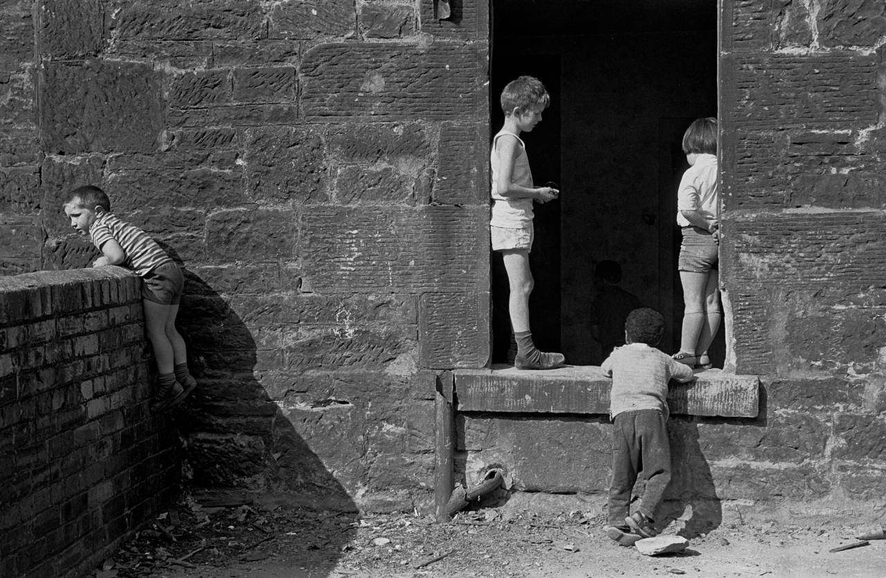 Children playing in an abandoned tenement Maryhill 1971