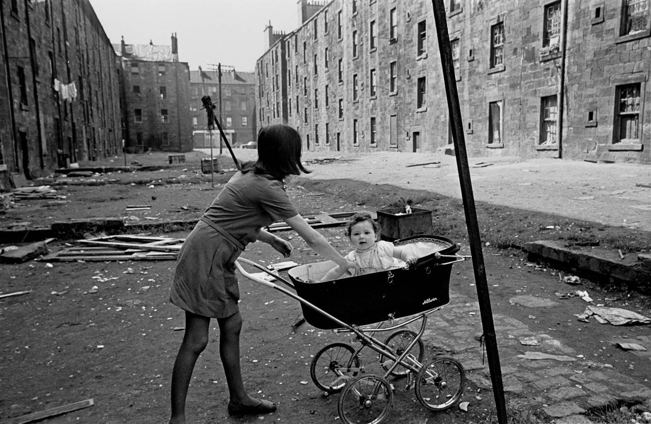 Mother and baby in Gorbals tenement courtyard 1970