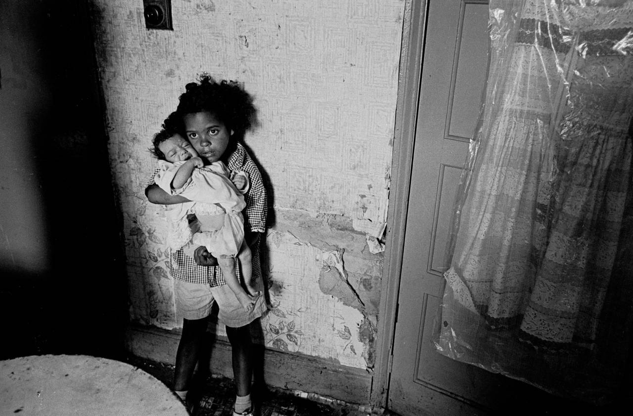 Young girl with her baby sister, slum property Balsall Heath 1970