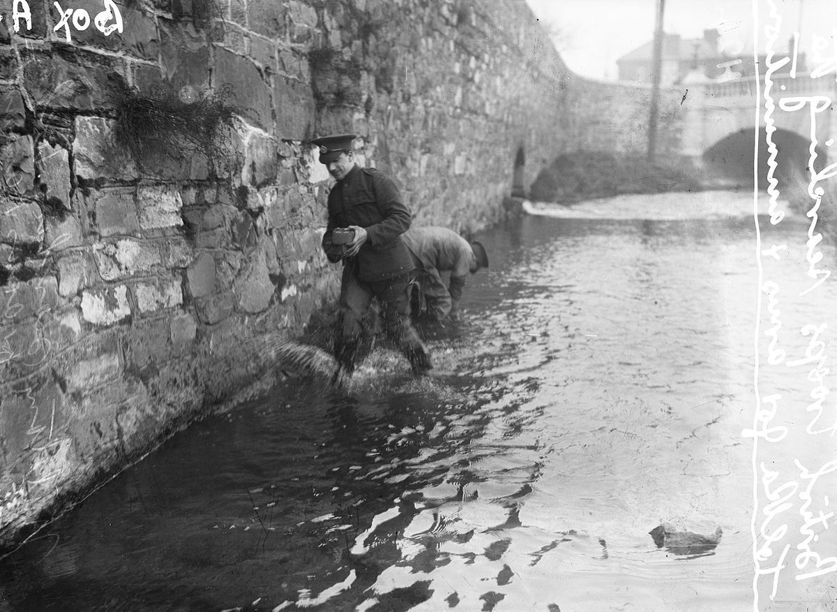 British soldiers searching the River Tolka in Dublin for arms and ammunition after the Easter Rising. May 1916