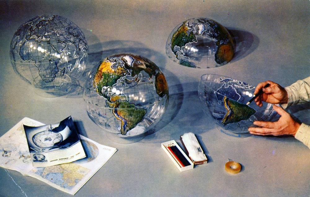 Farquhar Transparent Tool Globe Philadelphia PA simplifies teaching of geographic facts. It enables the student to see the world as a whole, with all parts in accurate relationship to each other and himself. Photograph shows how this teaching tool is prepared for use. Globe is furnished uncolored, as shown at left. In center is globe after coloring. Farquhar Transparent Globes 3724 Irving Street