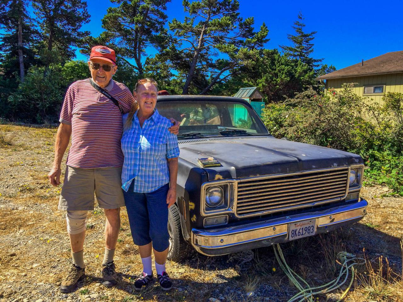 Aug 2015--Behind TJs Cafe--Port Orford, OR Old friends from my hometown, Fresno, CA, stopped by and took this snapshot of the missus and I in a vacant lot behind the restaurant where we had breakfast. The broken down California truck made a great prop for the picture.