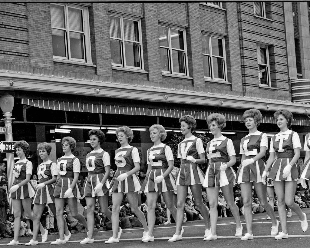 17 Nov 1962 Fresno Parade--02LR On Van Ness at the Tulare Street intersection in Fresno, California. The Chester Rowell Building is in the background. These are the Roosevelt High School letter girls.