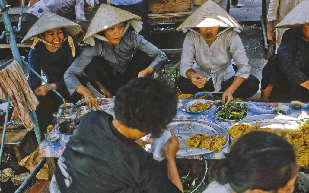 Busy with mid-day shoppers at the My Tho market in Dinh Tuong Province, Vietnam, in 1969.