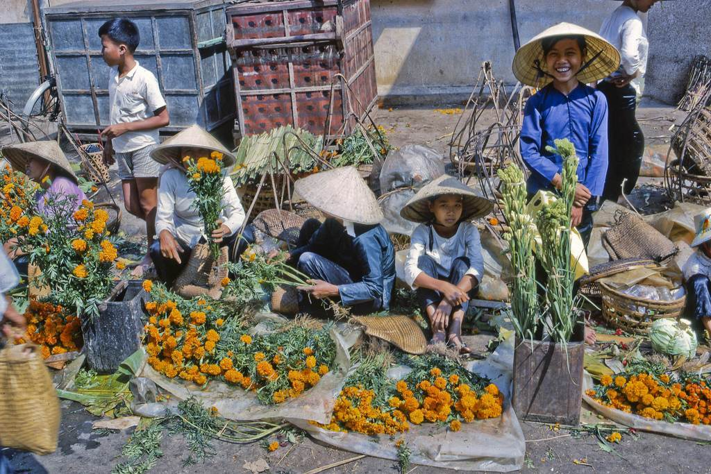 Marigolds for TET in 1969 Flower vendors selling for TET New Year celebration at the My Tho market in Dinh Tuong Province, Vietnam, in the year 1969.