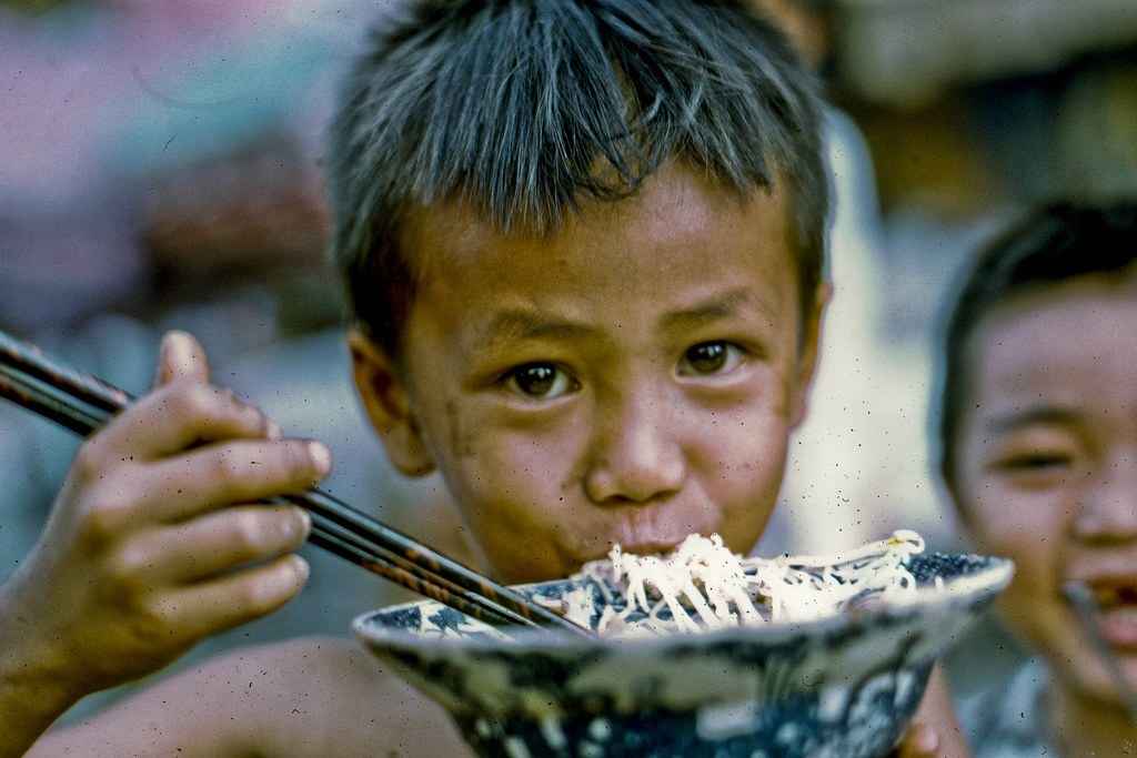 Noodle Gobbler in 1969 Seen on one of my My Tho walk-a-bouts in 1969. (Dinh Tuong Province, Mekong Delta of Vietnam) (scanned Kodachrome slide)