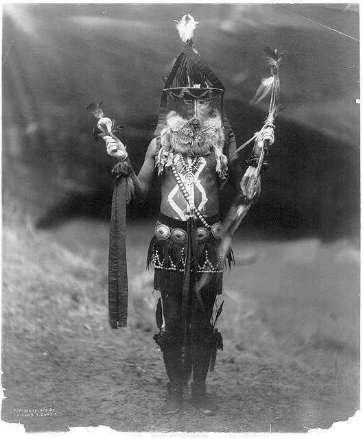 Title: Zahadolzhá--Navaho Creator(s): Curtis, Edward S., 1868-1952, photographer Date Created/Published: c1904. Medium: 1 photographic print : gelatin silver. Summary: A Navajo man, full-length, in ceremonial dress including mask and body paint.