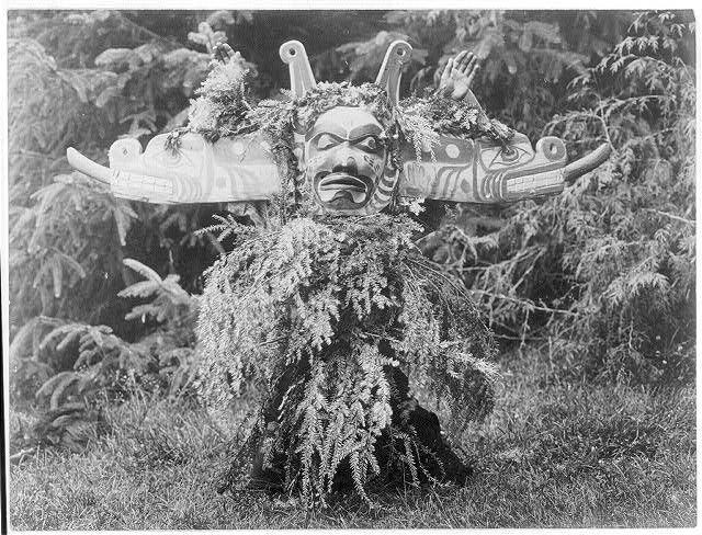 Title: Sisiutl--Qagyuhl Creator(s): Curtis, Edward S., 1868-1952, photographer Date Created/Published: c1914 November 13. Medium: 1 photographic print. Summary: Sisiutl, one of the main dancers in the Winter Dance ceremonies, wearing a double-headed serpent mask and shirt made of hemlock boughs.