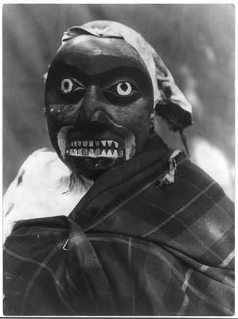 Date Created/Published: c1914 November 13. Medium: 1 photographic print. Summary: Ceremonial mask worn by a dancer portraying the hunter in Bella Bella mythology who killed the giant man-eating octopus. The dance was performed during Tluwulahu, a four day ceremony prior to the Winter Dance.