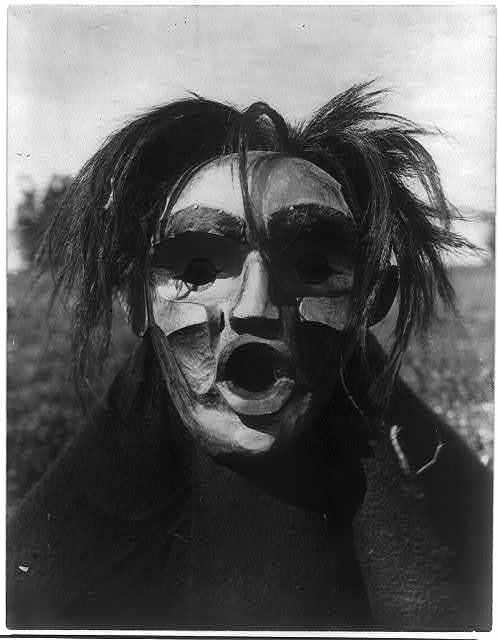 Title: Tsunukwalahl--Qagyuhl Creator(s): Curtis, Edward S., 1868-1952, photographer Date Created/Published: c1914 November 13. Medium: 1 photographic print. Summary: Person wearing Mask of Tsunukwalahl, a mythical being, used during the Winter Dance.