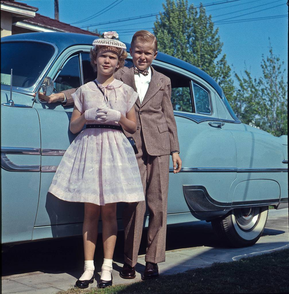 Ready for church at 4690 E White Fresno circa 1956 Dressed for church in front of the family's 1953 Pontiac at the family home in Fresno, California. Photo copywrited and owned by the Nix Family Trust. Misuse at your financial peril. Old colour slide taken by my dad.