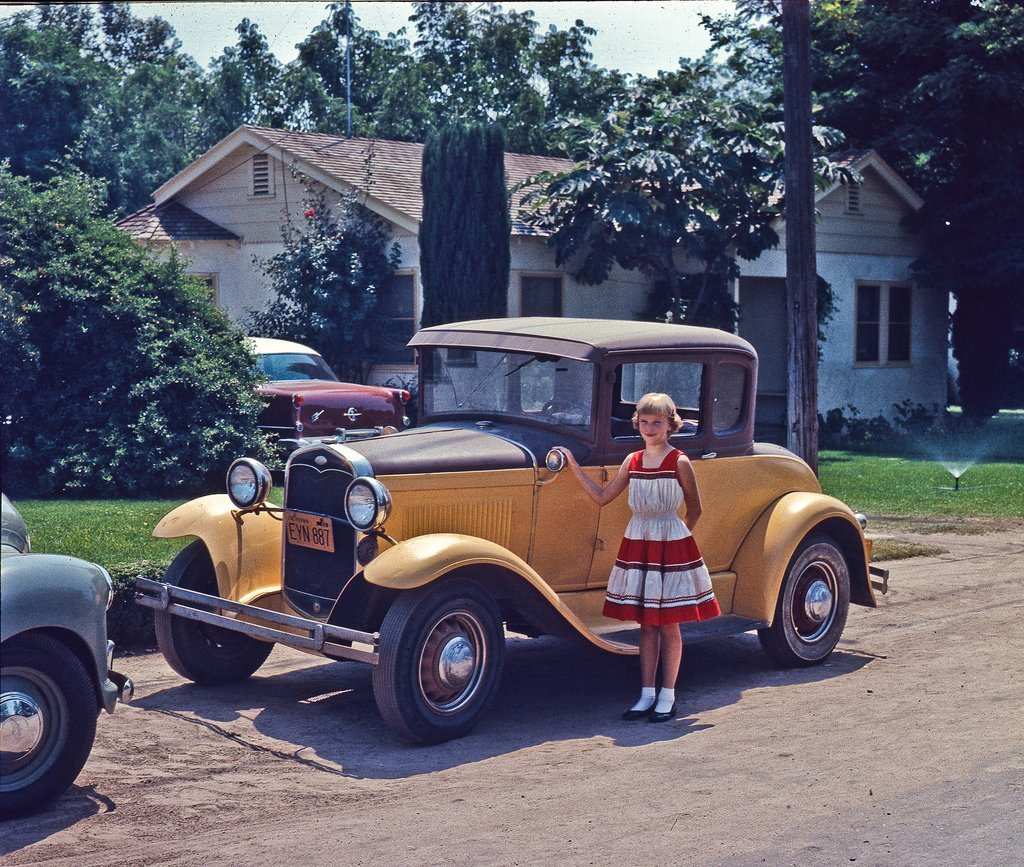 Dads Model A at 4690 E White Fresno in 1956 My little sister standing in front of my dad's work/commuter car. This is shortly before dad sold this car. The replacement, a little green Austin, is seen intruding into the picture from the left.