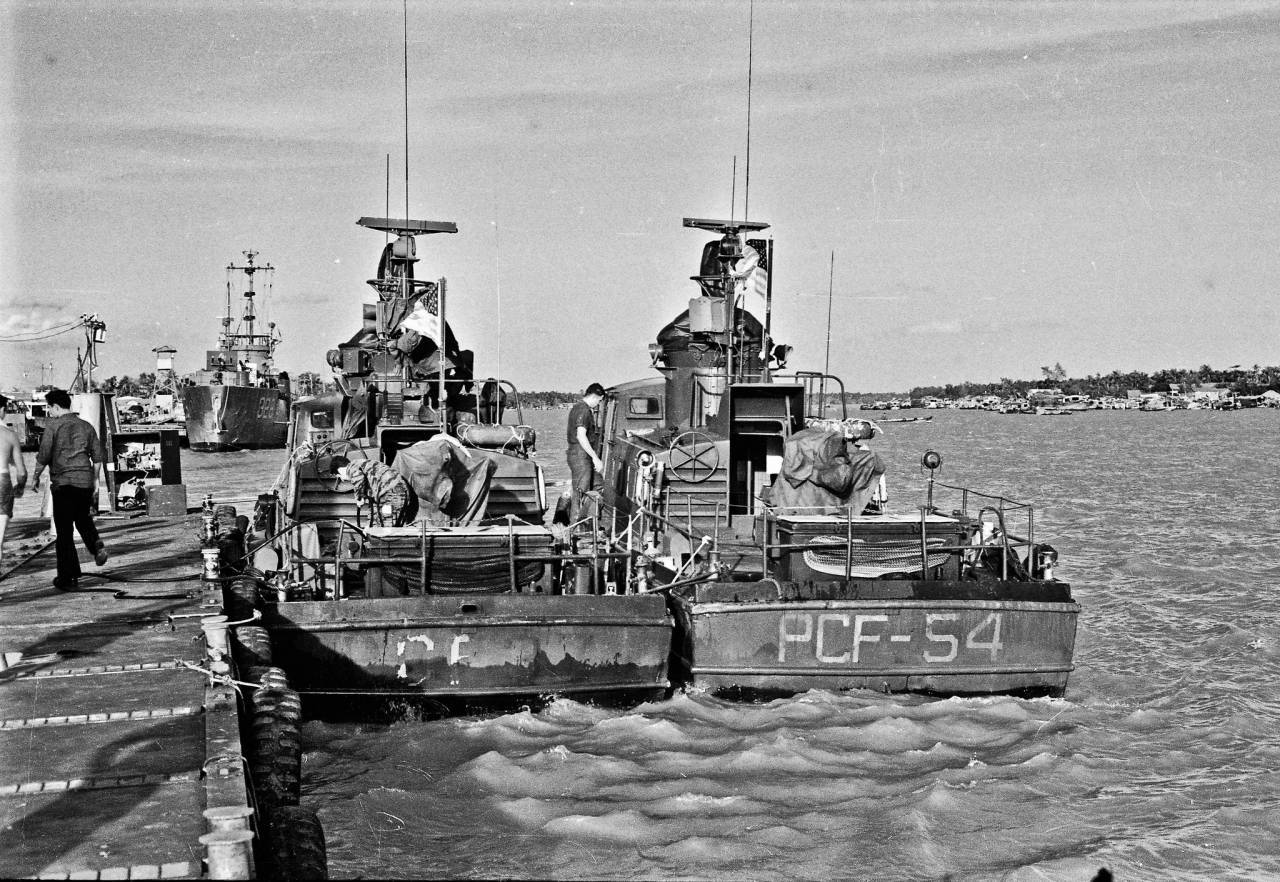 "Brown Water Navy PCF Swift boats Dec 1968--img076 A pair of Swift boats at the My Tho Navy docks on the Mekong River. Known as PCF's for Patrol Craft Fast, they were about 50 feet long and made of aluminum. Just a block or so south of the Dinh Tuong Provincial Phoenix HQ I worked out of during my ""vacation"" to the VIetnam war."