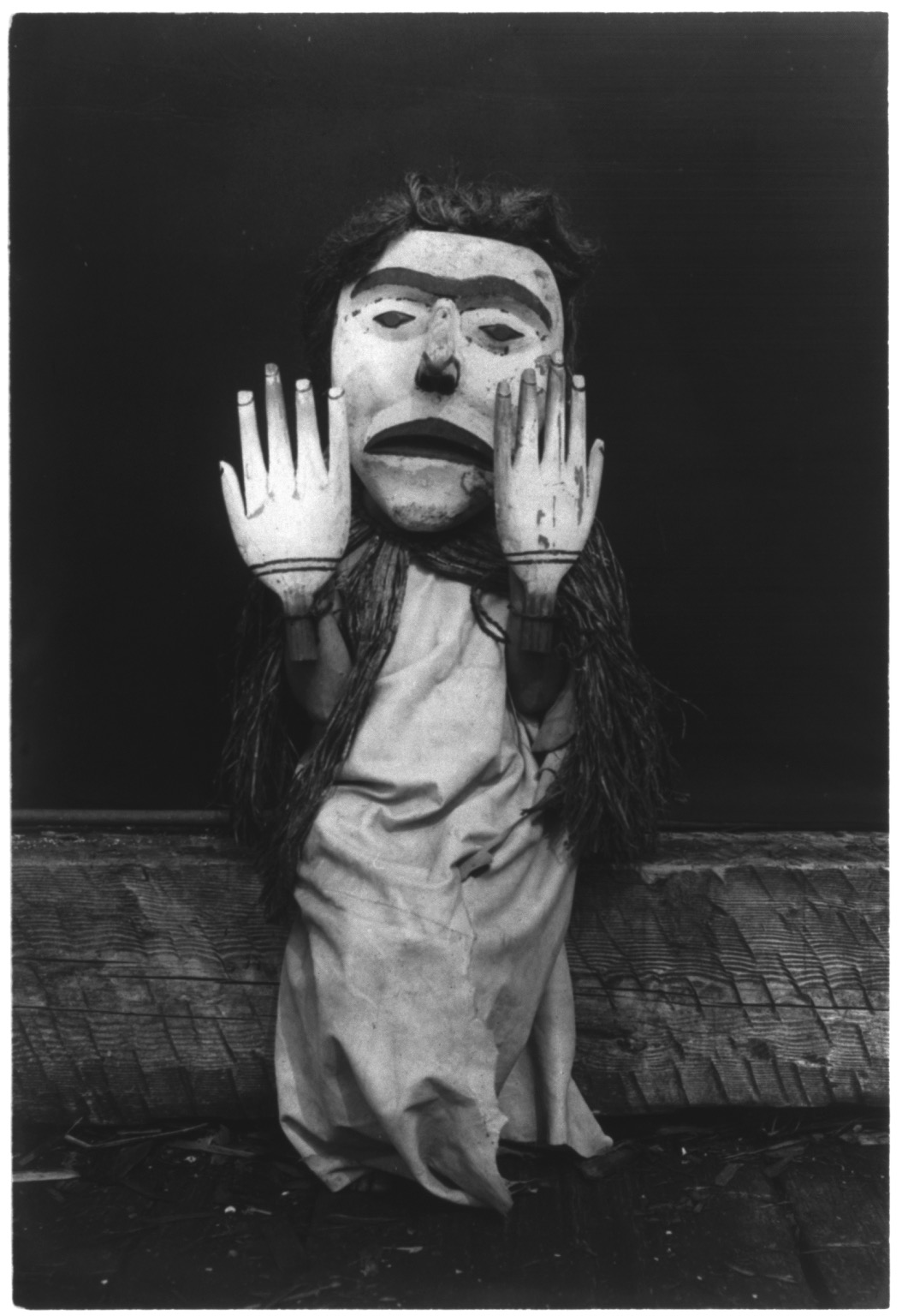 "Title Nuhlimkilaka--Koskimo Summary Kwakiutl person wearing an oversize mask and hands representing a forest spirit, Nuhlimkilaka, (""bringer of confusion""). Contributor Names Curtis, Edward S., 1868-1952, photographer Created / Published c1914 November 13."