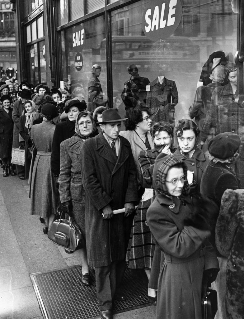 28th December 1951: Shoppers queuing outside Peter Robinsons in Oxford Street, London, for the start of the sales. (Photo by Monty Fresco/Topical Press Agency/Getty Images)
