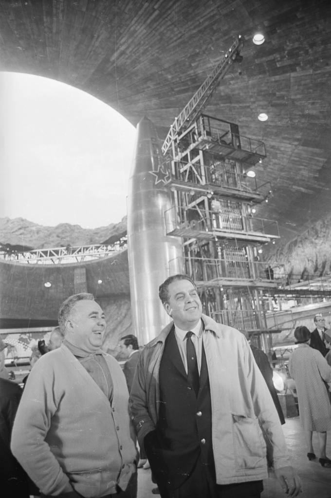 28th October 1966: Co-producers Harry Saltzman (1915 - 1994, left) and Albert Broccoli (1909 - 1996) on the massive purpose-built Pinewood set of the new Bond film 'You Only Live Twice', directed by Lewis Gilbert. (Photo by Larry Ellis/Express/Getty Images)