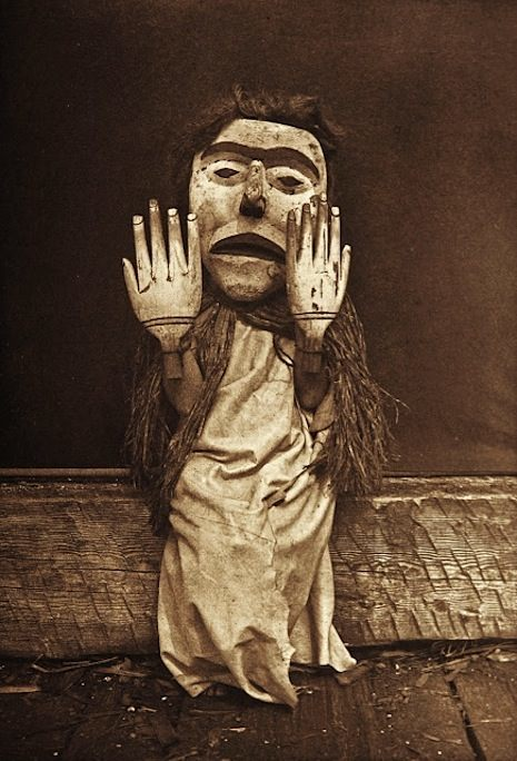 "Title: Nuhlimkilaka--Koskimo Creator(s): Curtis, Edward S., 1868-1952, photographer Date Created/Published: c1914 November 13. Medium: 1 photographic print. Summary: Kwakiutl person wearing an oversize mask and hands representing a forest spirit, Nuhlimkilaka, (""bringer of confusion"")."