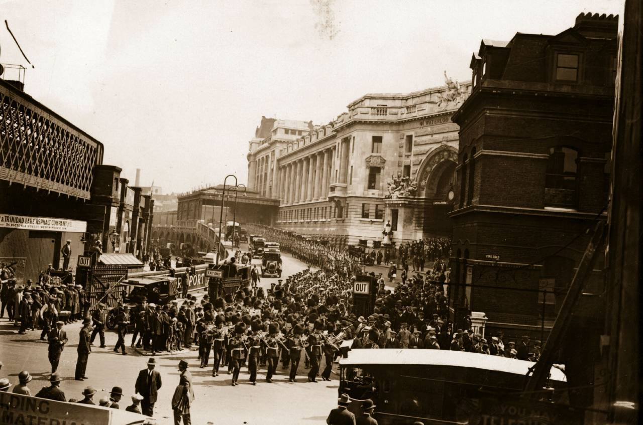 15th August 1928: The 1st Battalion Prince of Wales' Volunteers leaving Waterloo Station headed by the Guards Band, on their way to Buckingham Palace. (Photo by Crouch/Topical Press Agency/Getty Images)