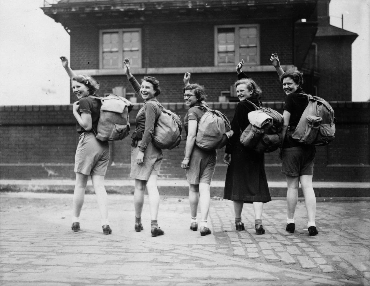 15th May 1937: A group of female hikers wave goodbye outside Waterloo Station, London, before setting off on a walking holiday. (Photo by E. Dean/Topical Press Agency/Getty Images)