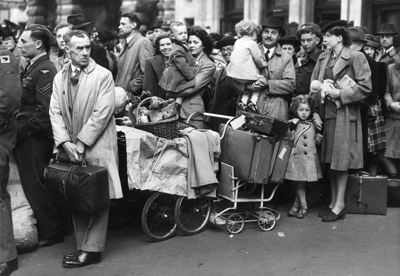 17th April 1946: Easter holidaymakers waiting in line at Waterloo station, London, for the long distance train. (Photo by William Vanderson/Fox Photos/Getty Images)