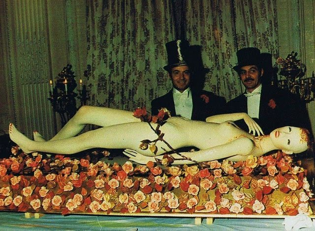 A sugar made woman laying in a bed of roses desert