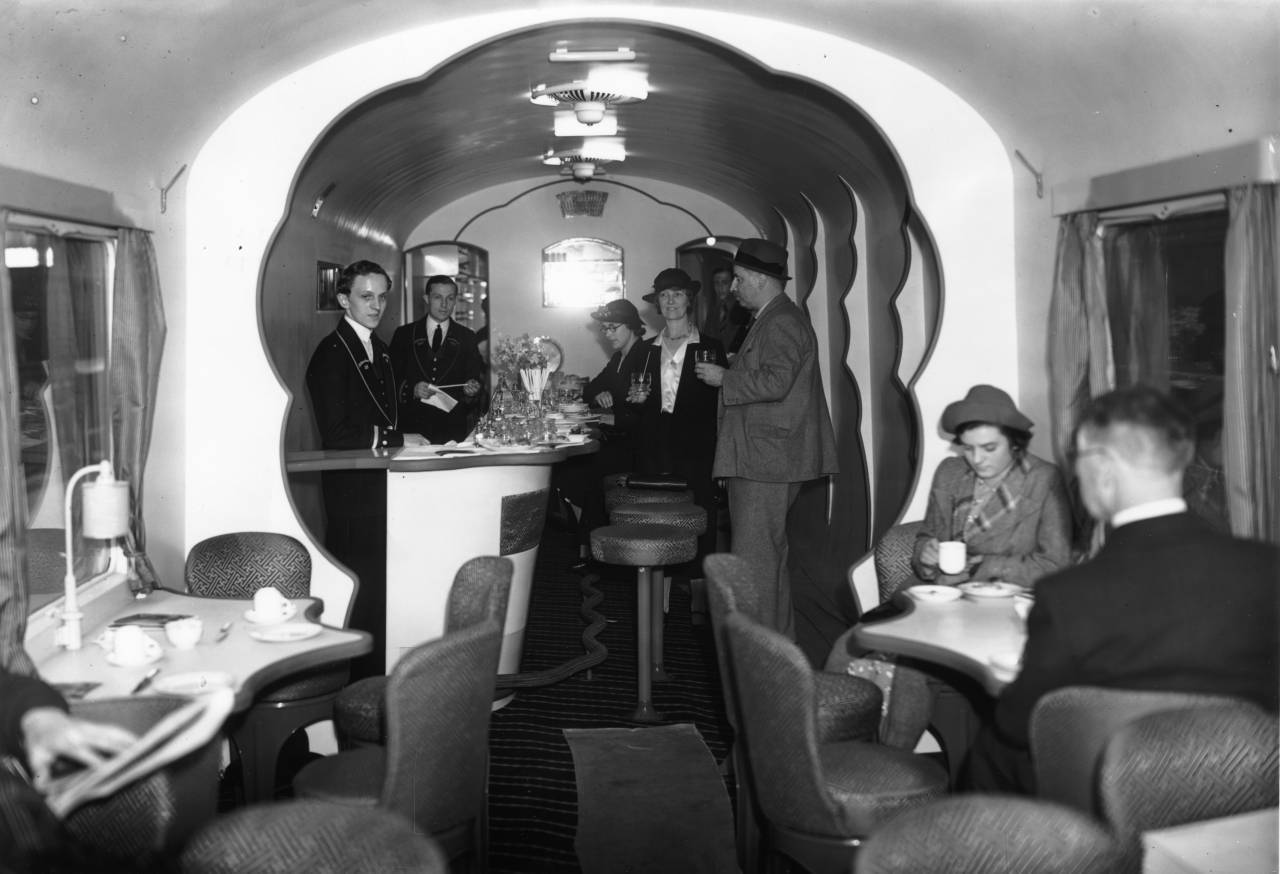 27th June 1938: A corridor buffet car built for the new electric main line from London to Bognor Regis, Chichester and Littlehampton districts on show at Waterloo station, London. (Photo by J. A. Hampton/Topical Press Agency/Getty Images)