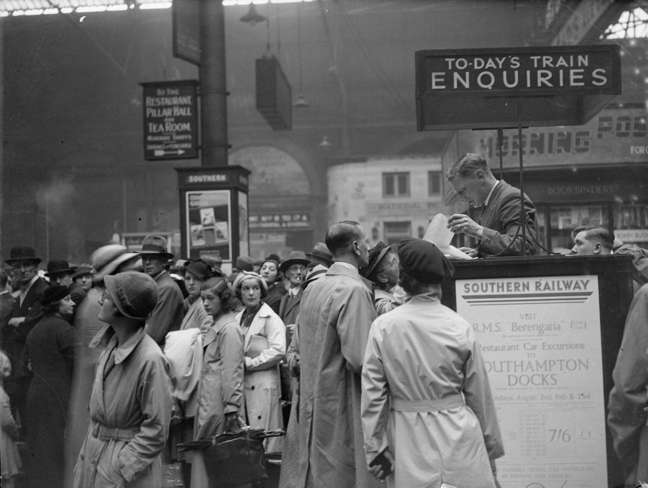 August 1936: Crowds at the Enquiry Desk in Waterloo Station, London. (Photo by Harry Shepherd/Fox Photos/Getty Images)