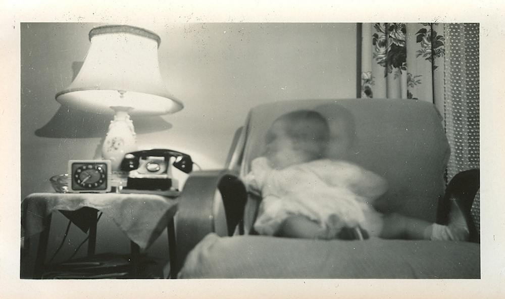 A cute snapshot. On the back: Sept 21 1947 Louise in the den at 37 Marin? Heights 1 yr.