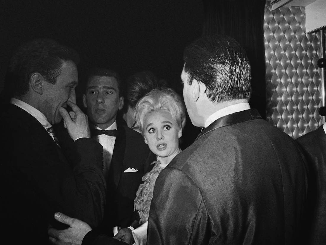 12th May 1965:  From left to right, actor George Sewell, London gangster Reggie Kray, actress Barbara Windsor and Reggie's brother Ronnie Kray, at the El Morocco nightclub.  (Photo by Larry Ellis/Express/Getty Images)