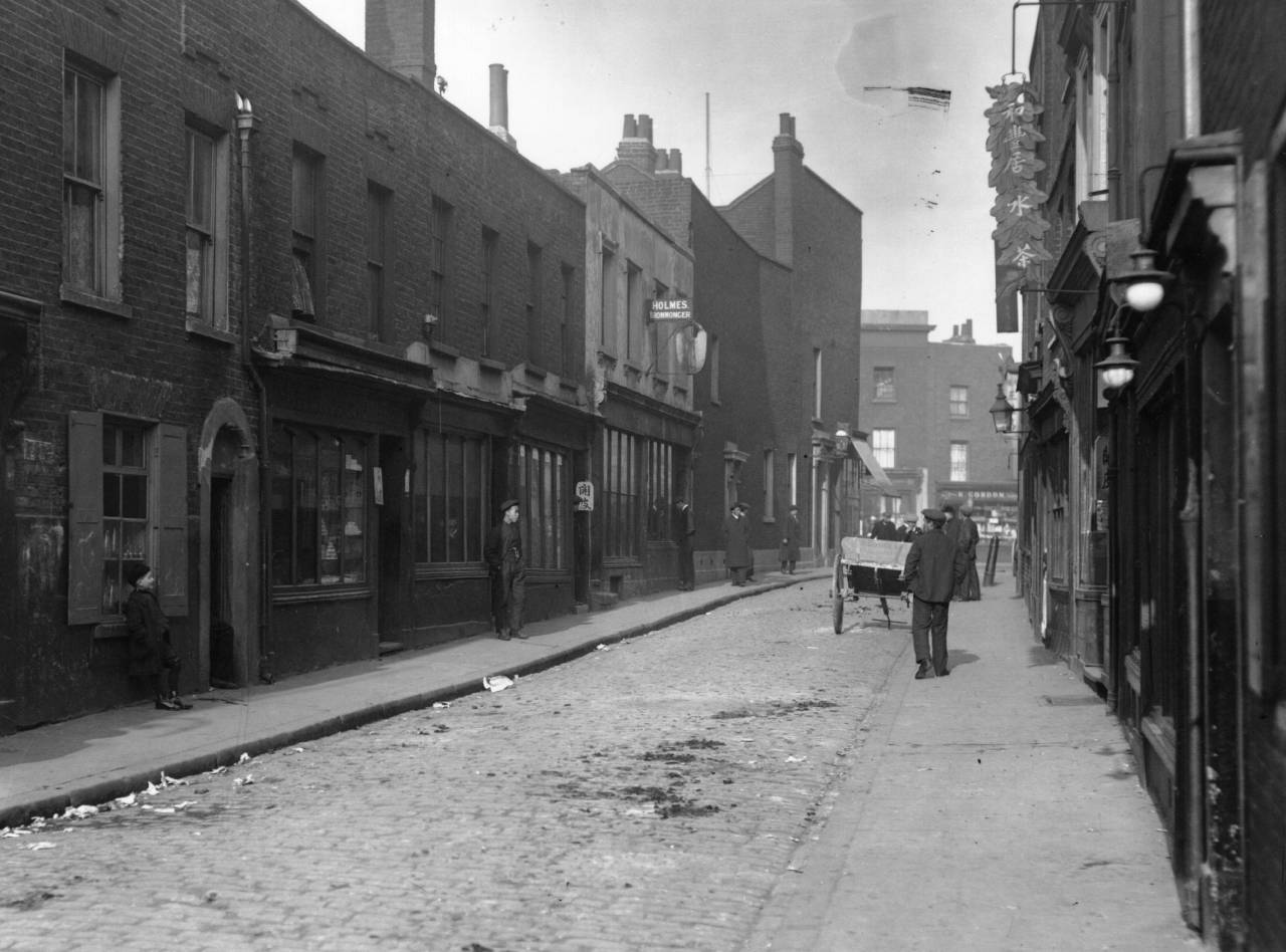 April 1911: A street in China Town in London's East End, home of the Wo Fung Goy Chinese cafe. (Photo by Topical Press Agency/Getty Images)