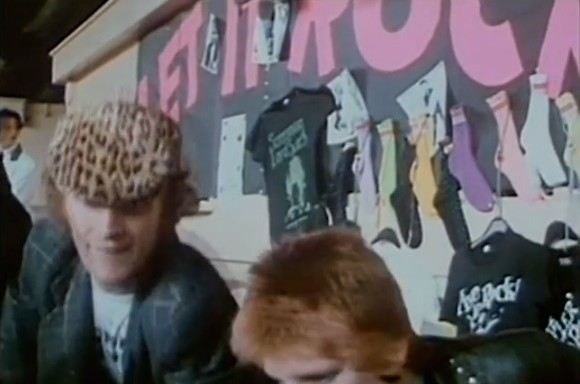 T-shirt displayed at the Let It Rock stall at Wembley. McLaren and assistant Yvonne Gold in the foreground. From London Rock N Roll Show, directed by Peter Clifto