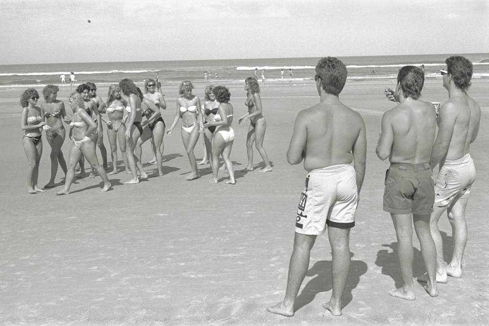 A group of boys check out a group of girls at the beach in Daytona Beach, Fla. in 1987.
