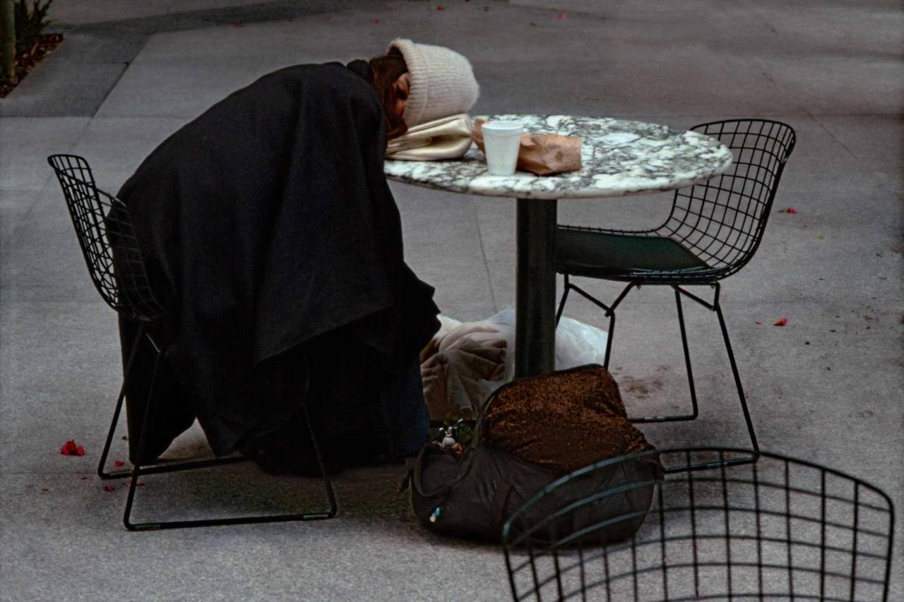 1984, New York, homeless woman asleep at a table
