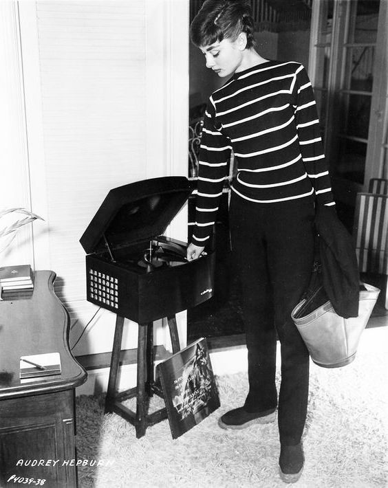 Playing records in her hired apartment on Wilshire Boulevard. Photograph by Mark Shaw.