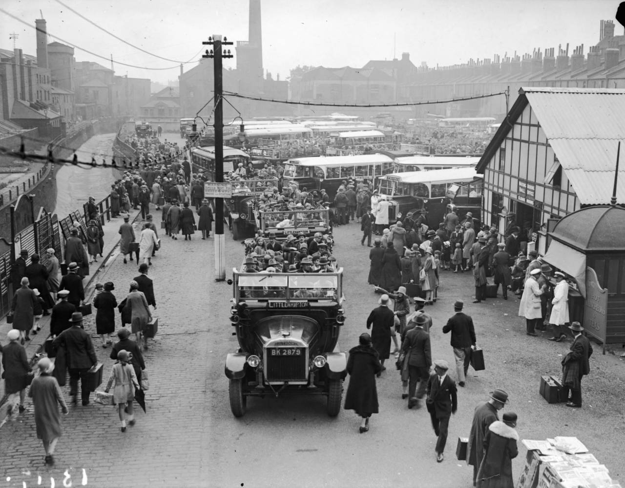 3rd August 1929: Passengers aboard open top buses at Victoria Motor Coach Station. (Photo by Fox Photos/Getty Images)