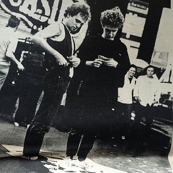 Hauser's shot of Johnston and McLaren counting their winnings on the Strip in Vegas, as it appeared in Slash #11, July 1978. © Fayette Hauser