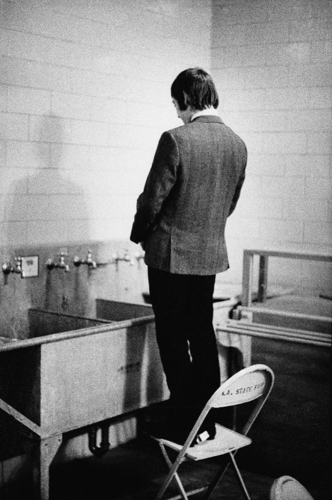 Just Charlie pissing in a sink at the LA Memorial Sports Arena, December 1965