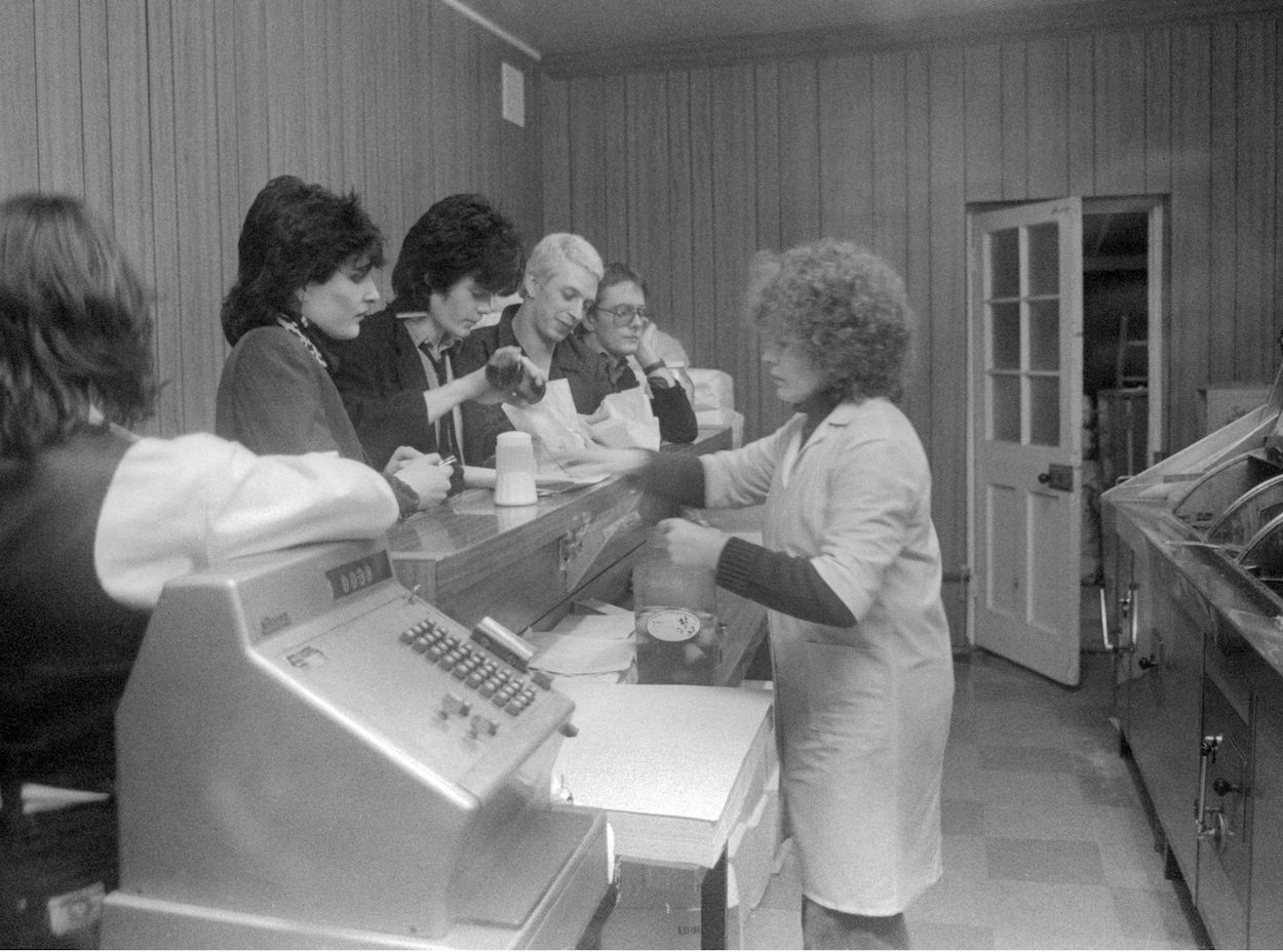 Mandatory Credit: Photo by Ray Stevenson/REX/Shutterstock (671388ar) Siouxsie and the Banshees in a chip shop - 1978 Siouxsie and the Banshees