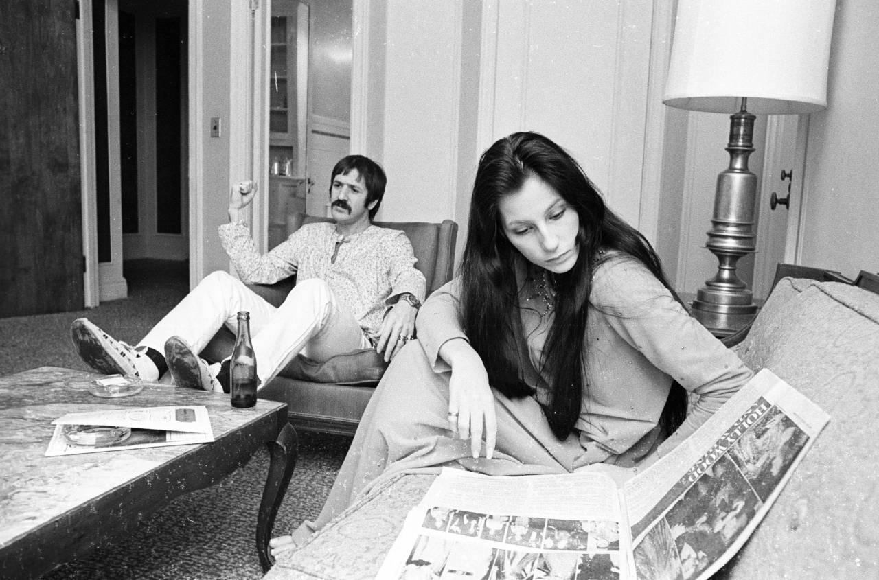 Sonny and Cher reading a copy of Women's Wear Daily - 16 Apr 1969