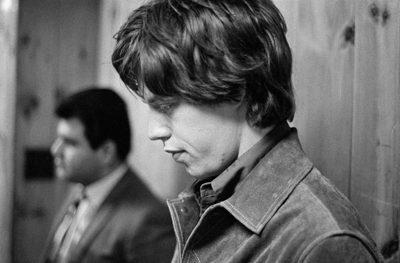 Mick with promo-man Pete Bennett (1965) 'The hours before and between shows were often pretty boring and contemplative. Mick is pictured here waiting to go on stage. Behind him is the great record plugger Pete Bennet who engineered Get Off my Cloud to number one as the band criss-crossed the country'