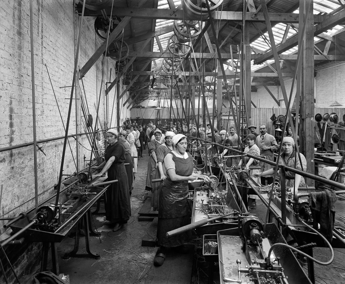 September 1918 Belgian refugee women use lathes to make ammunition casings at the Belgian Munition Works in London.