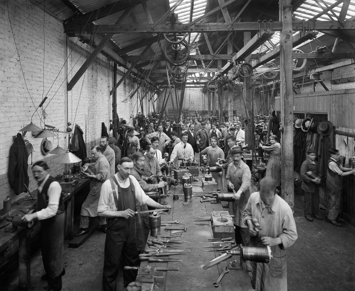 September 1918 Belgian refugees manufacture artillery shells at the Belgian Munition Works in London.