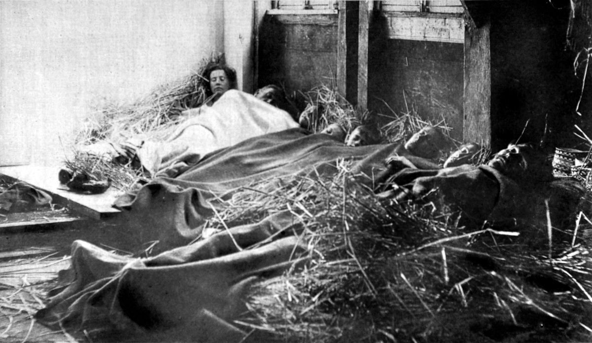 Dec. 24, 1914 Belgian refugees sleep in a barn in France on Christmas Eve.