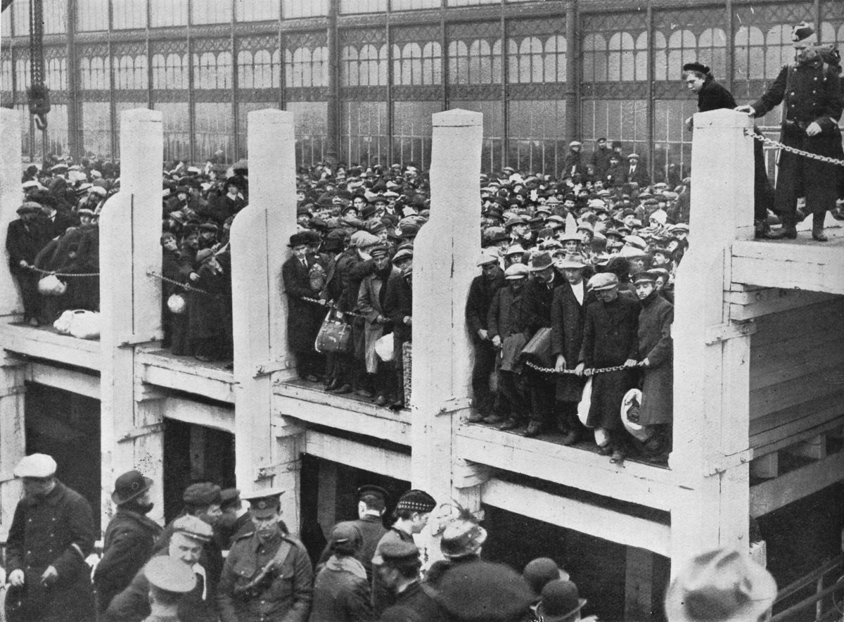 1914 Belgian refugees on the harbour at Ostend waiting for a boat to take them to England.