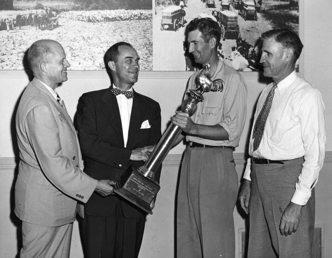 First Prize Winner of Chicken-Of-Tomorrow Contest Subjects: Poultry Awards Item identifier: ua023_007-007-bx0022-002-007 Created Date: 1949 Description: Transcribed from back:Left to right: H. L. Shrader, USDA; Lloyd A. Bell, A&P Food Stores; H. Bernard Helm's, Monroe, N. C. and C. J. Mairpin