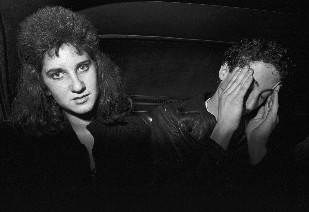 Friends drunk in car, 1980.