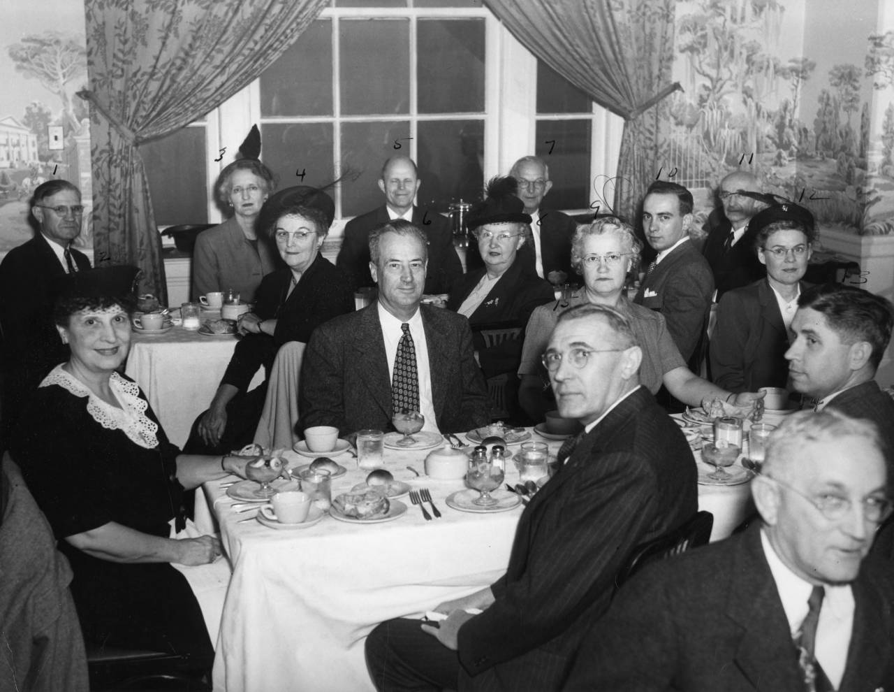 "Regional Meeting of Chicken of Tomorrow Contest Leaders Subjects: Poultry Item identifier: ua023_007-007-bx0022-002-002 Created Date: 1949-10 Description: Transcribed from back: Oct. 1949 Sir Walter Hotel-Raleigh, N. C. Regional Meeting of ""Chicken of Tomorrow"" contest leaders. 1- C. J [illegible] 2. Mrs. R. S. Dearstyne 3-4 [blank] 5-H. L. Shrader 6-R. S. Deastyne 7-I. O Schaub 8-Mrs. Schaub 9-Mrs. C. F. Parrish 10-[blank] 11-Dr. Peirce 12-Mrs. O. E. Golf 13-Ted H. Ash - W. Va. 14-Peterkin - S.C. 15-[illegible]"
