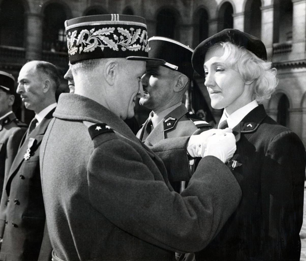 Mandatory Credit: Photo by KeystoneUSA-ZUMA/REX/Shutterstock (1380859e) Dancer Lydia Lova, former member of the French Resistance, receives her Legion of Honor from General Henri Masson during a ceremony held at the Invalides, Paris, France Various
