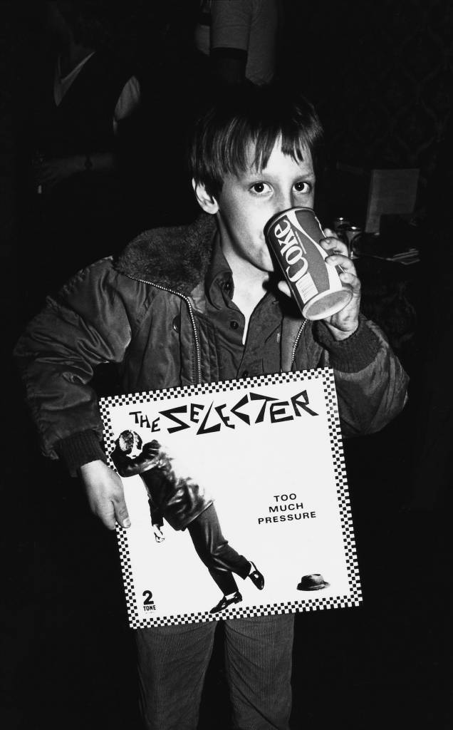 A young boy holding a Selecter album, drinking Coca Cola, Ska, 2 Tone, Coventry, UK 1980