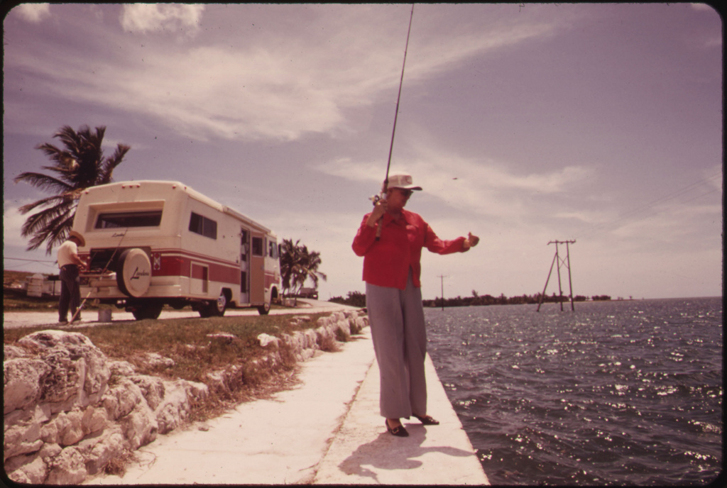 A Retired Couple From California Stop to Fish Off Embankment at Spanish Harbor Key. Travel-Trailers of the Kind Owned by This Couple Are Highly Popular Among Visitors to the Keys.
